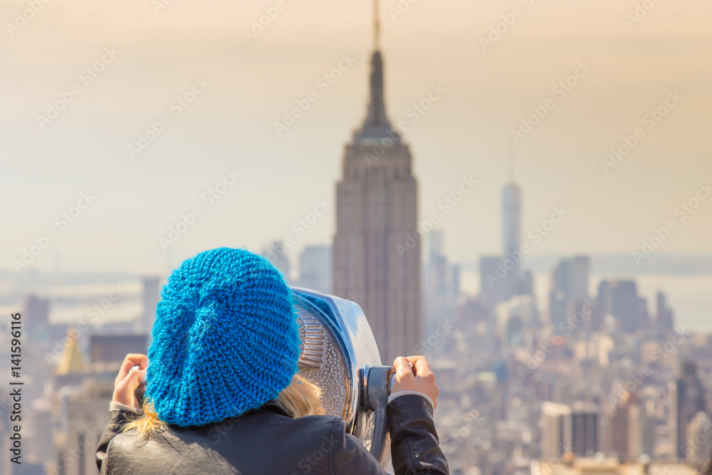 Fototapety, obrazy: Woman enjoying in New York City panoramic view. Manhattan downtown skyline with illuminated Empire State Building and skyscrapers seen from observation deck terrace.