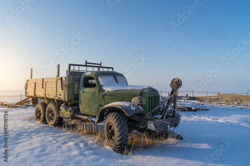 Russian old truck covered by snow in the winter  Baikal lakeI