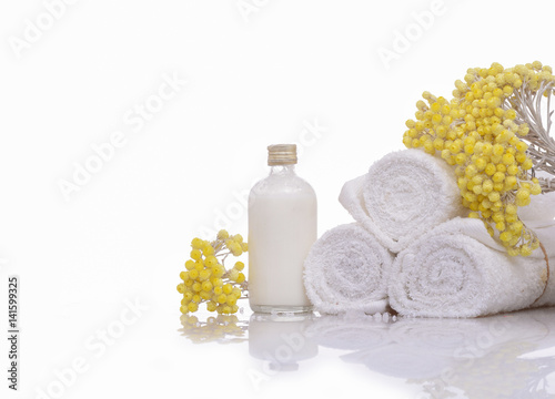 Keuken foto achterwand Spa Products for spa towel, spa oil, branch yellow flower