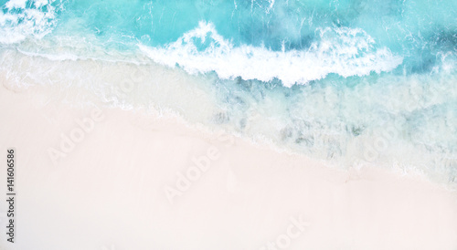 Keuken foto achterwand Luchtfoto Beautiful tropical white empty beach and sea waves seen from above. Seychelles Grand Anse beach aerial view