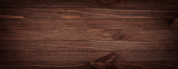 Fototapeta Dark brown scratched wooden cutting board. Wood texture background