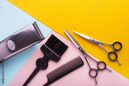 Professional hairdresser tools on colored background