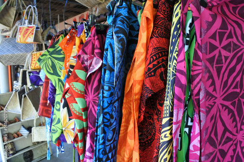 Fotobehang Paradijsvogel Tropical men shirts on display in the market