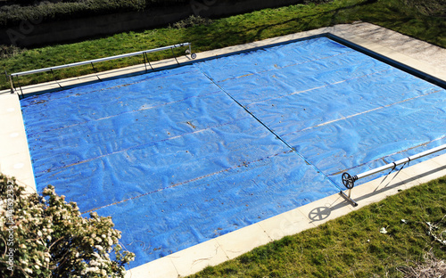 Swimming pool protected with a blue tarp in autumn – kaufen ...