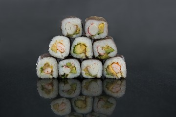 FototapetaStack of sushi on black background