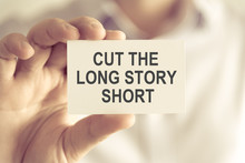 Businessman Holding CUT THE LONG STORY SHORT Message Card