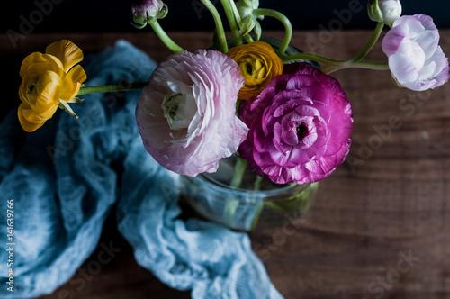 Fotografie, Obraz  Dark and moody image of colorful ranunculus flowers