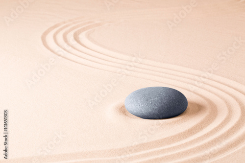 Foto op Plexiglas Stenen in het Zand Zen meditation stone garden background. Stone on fine sand standing for balance, harmony concentration and relaxation...