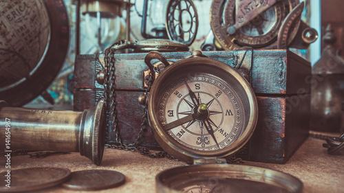 Foto auf AluDibond Schiff Old collection compass, telescope and wooden treasure chest.