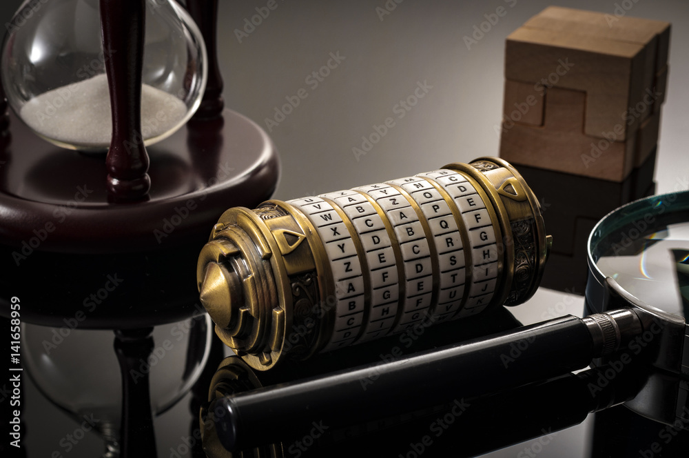 """Fototapeta Escape the room or escape game, is a physical game where players are locked in a room and a required to examine clues and solve a puzzles. The word """"Xcape"""" is the password for this cryptex riddle"""