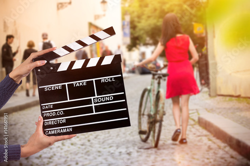 Valokuva  Clapperboard sign hold by female hands.
