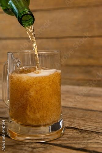 Fotografie, Obraz  Beer being poured into a mug