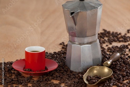 Photo Coffee beans, coffee, coffeemaker and scoop