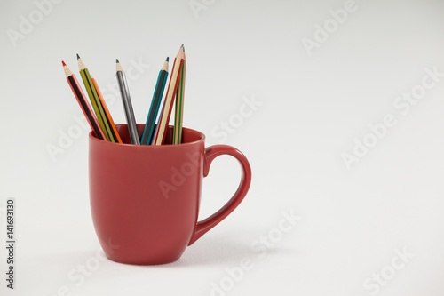 Colored pencils kept in cup