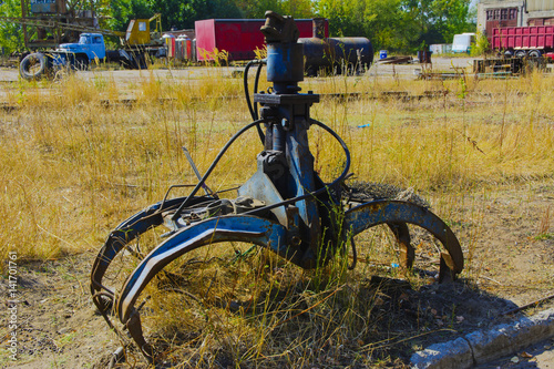 Fotografie, Obraz  Old rusty hydraulic grapple to collect scrap metal