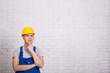 thinking builder in uniform and copy space over white wall