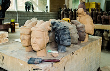 Process Of Restoration Of Clay Figures Of The Soldiers Of The Terracotta Army. Xian, China