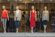Women Clothing Store With Mannequins In Showcase
