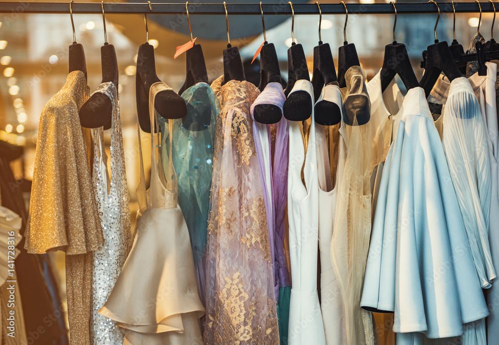 Fototapeta Colorful clorhes on racks in a fashion boutique