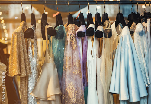 Colorful clorhes on racks in a fashion boutique - fototapety na wymiar