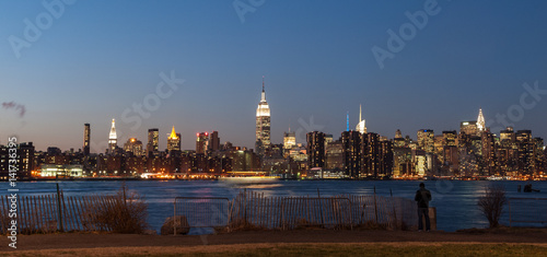 Fototapeta View of New York city skyline at twilight from Williamsburg in Brooklyn.