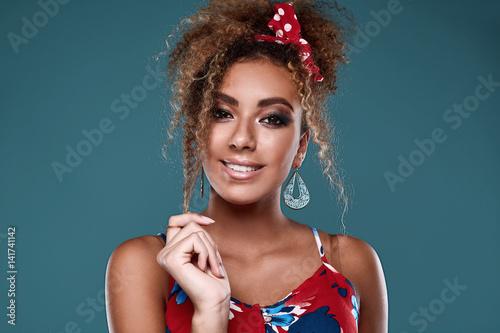 Elegant black woman model with curly hair in red dress Fototapeta
