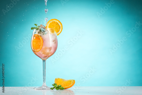 Fotografie, Obraz The rose exotic cocktail and fruit on blue