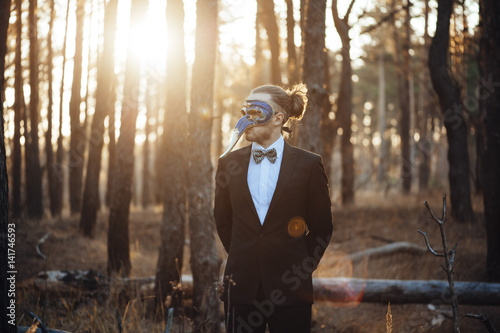 Fotografering  Mysterious handsome businessman in a traditional venetian mask, wearing a suit i