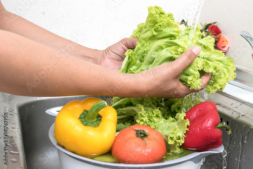Canvas Prints Fresh vegetables Woman hands are washing vegetables in kitchen