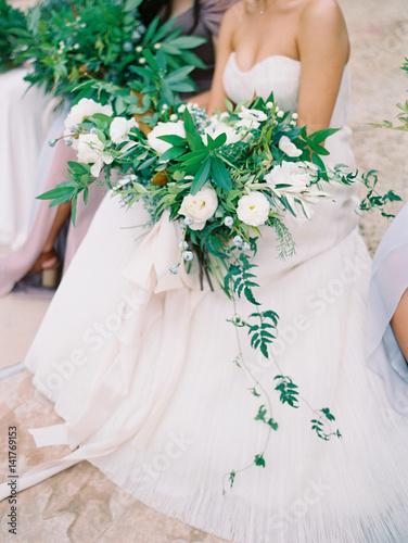 Plakát Bride in white dress holding bouquet