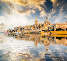 Scenic View Of Marsamxett Harbour And Valletta In Malta At Sunset With Reflection