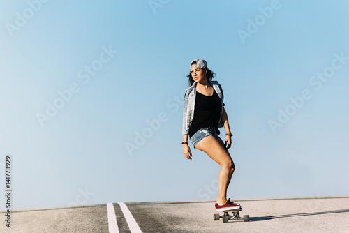 Valokuva Beautiful skater woman riding on her longboard.
