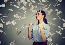 Happy Woman Celebrates Success Under Money Rain Falling Down Dollar Bills