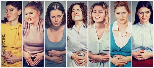 Valokuva  Group of young women with hands on stomach having bad aches pain