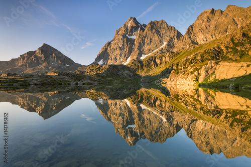 Italy, Piedmont, Cuneo District, Po Valley, Crissolo - Summer sunrise at Superiore Lake