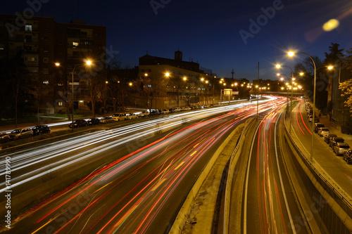 Foto op Aluminium Nacht snelweg Rays of lights, car lights on a road, at night