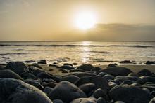 Sunset On A Rocky Shore