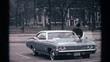 1968: man getting into the driver's seat of an old car CHICAGO ILLINOIS