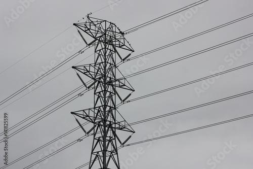 Valokuva  Transmission tower with a gray sky