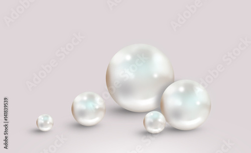 Five white pearls on grey pink background