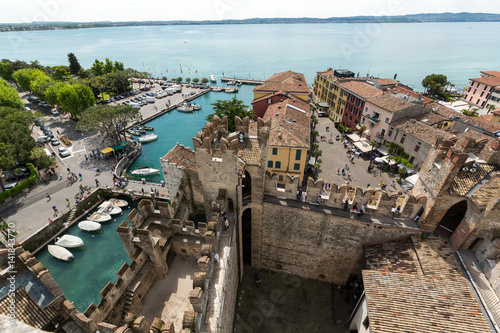 Tuinposter Schip View of colorful old buildings in Sirmione and Lake Garda from Scaliger castle wall, Italy