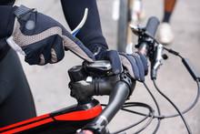 A Mountain Bike Cyclist Adjust...