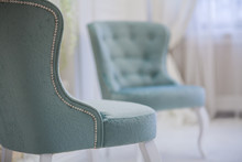 Two Turquoise Classic Luxury Armchair In White Room. One Mint Chair Standing Back To Camera. Close-up.