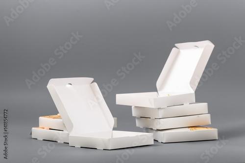 Fototapeta Pizza boxes on a gray background. Isolate obraz na płótnie