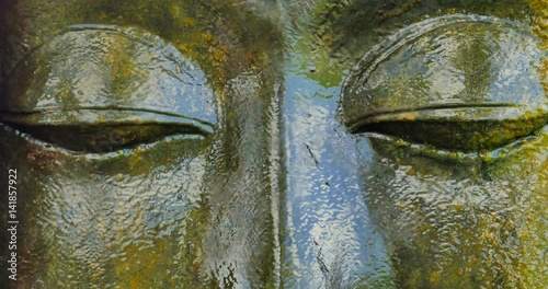 Photo  Close up eyes of ancient Buddha Statue face in religious Buddhist complex in Ubu