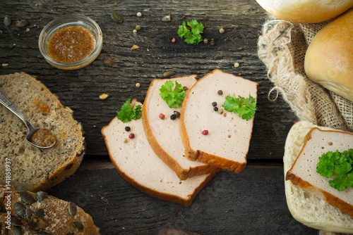 Photo  Traditional Bavarian meat loaf with a brown crispy crust pepper parsley  on rust