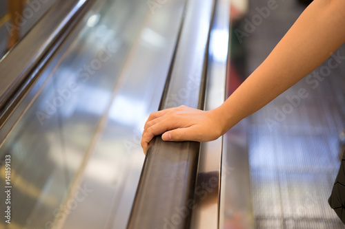 Point of view of a women riding an escalator to the second floor of the mall Wallpaper Mural