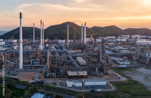 Poster London Aerial view Oil refinery with a background of mountains and sky.The factory is located in the middle of nature and no emissions. The area around the air pure.