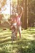Senior man with granddaughter in bicycle basket.