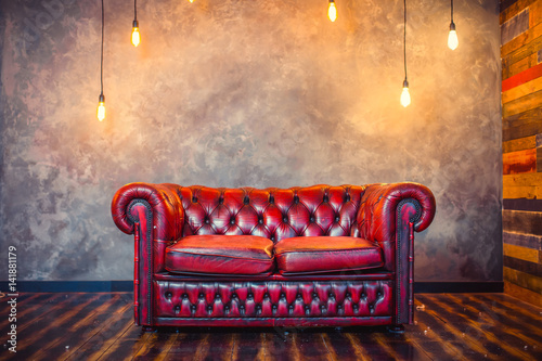 Fotografie, Obraz  Red sofa couch in vintage room with lamps